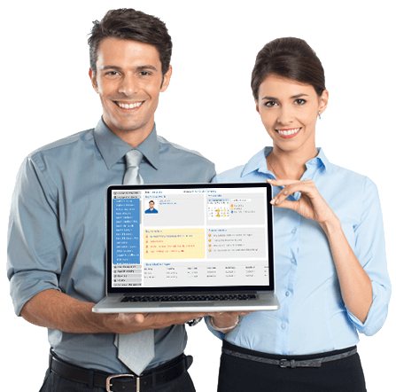Man and woman holding computer showcasing iSolved HCM Software